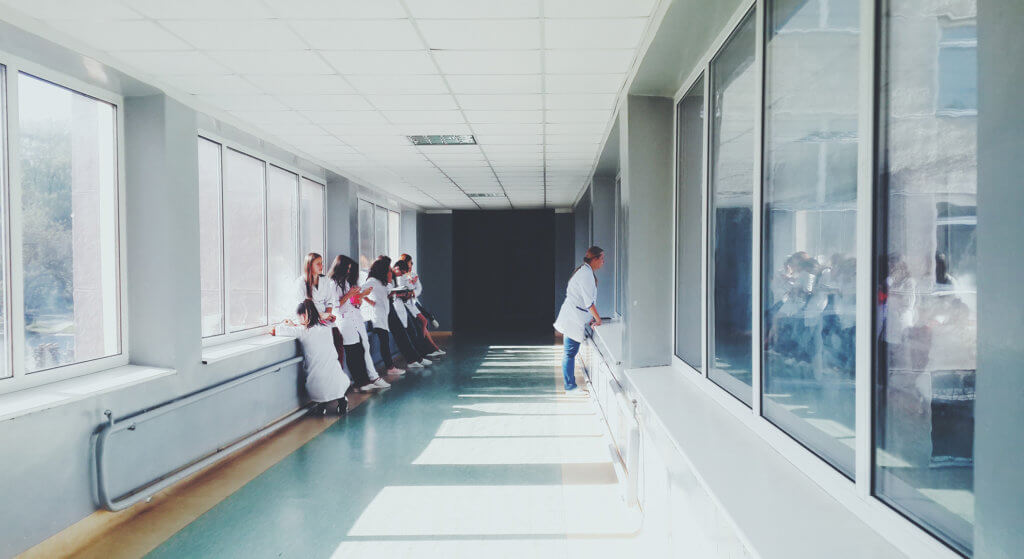 Healthcare professionals standing in a hallway
