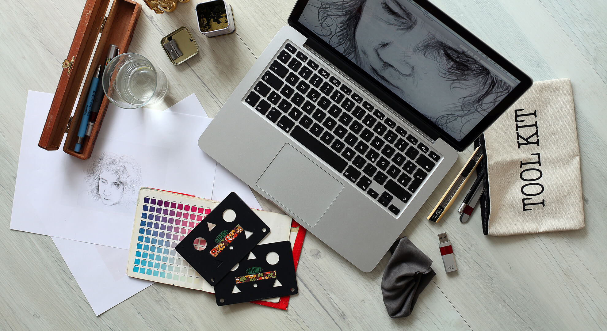 laptop with hand drawing and tools